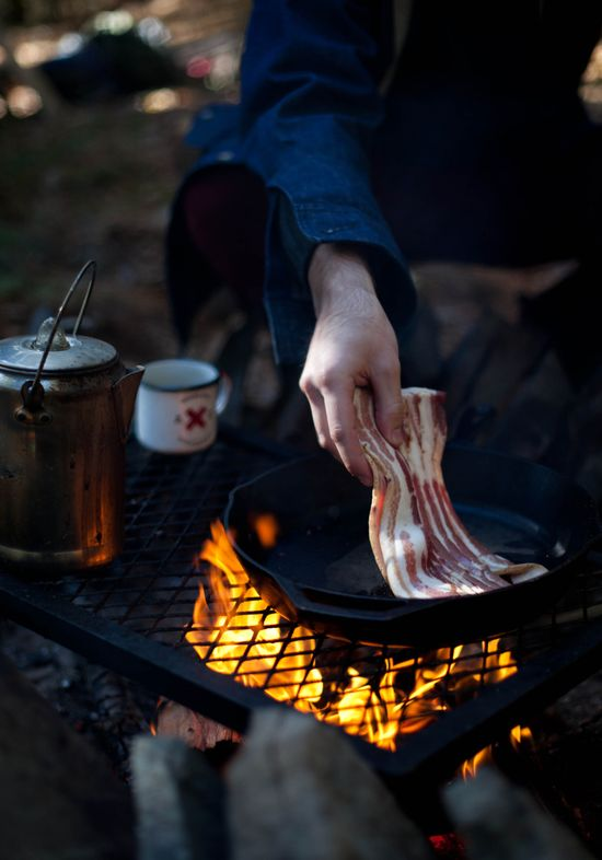 Cooking on a campfire.