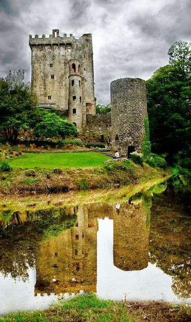 """Blarney Castle with its moat, in Ireland. Home of the """"Blarney Stone"""" where you bend over backwards to kiss the Blarney Stone to be bestowed with the gift of Eloquence."""