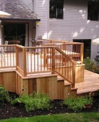 A wood deck can turn any backyard from ordinary to extraordinary. This multi-level design not only offers expansive areas for outdoor entertaining, but provides easy access from the second floor to the backyard. The paneled sides add a finished look to the installation.