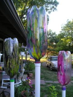 """very cool...""""garden harps"""" made out of plastic bottles. The wind blows through them making different sounds.These would be really neat painted as ghosts for halloween! (there is a link on the page to hear the sounds they make)"""