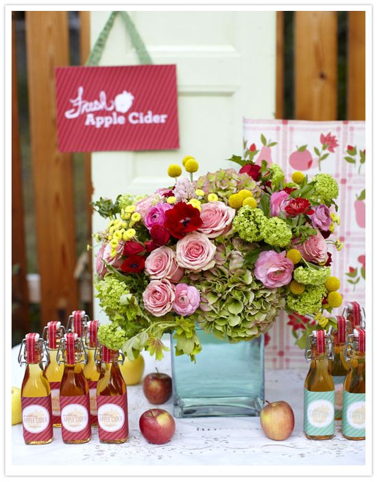 flowers and cider as a wedding favor!