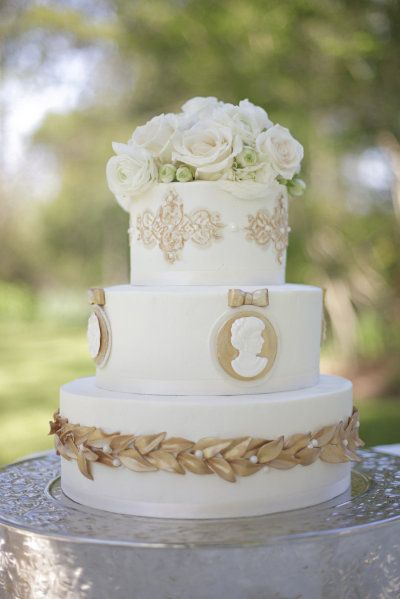 wedding cake adorned with cameos