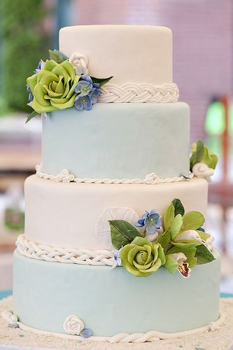 white cake, blue cake with green flowers!