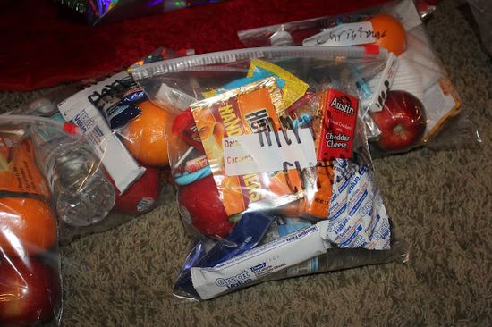 NEW Favorite Holiday Tradition- Make care packages, with letter of love, kids art, pic of Christ, hand warmers, snacks, ponchos, mcdon. few dollar coupons... Hand out to homeless on corners.