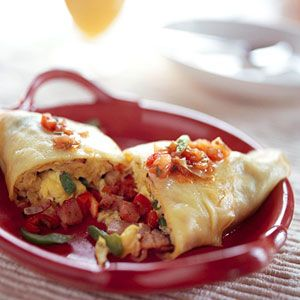 A ham and cheese omelet rolled in a crepe makes a filling breakfast. Perfect for brunch, too.