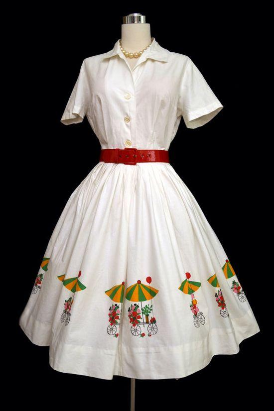 Darling flower cart novelty print 1950s/60s shirtwaist dress. #vintage #1950s #1960s #summer #fashion #dresses