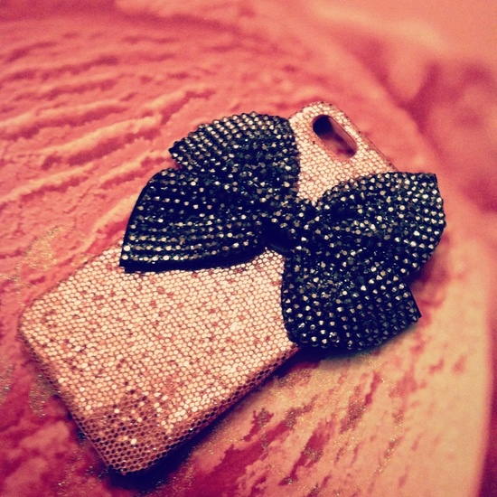 iPhone 5 Pink Glitter and Big Silver Studded Bling Bow case. $28.00, via Etsy.