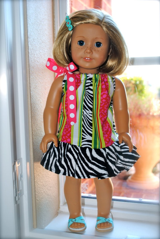 The CrazyDay print has fun, bright stripes in Pink, Green and Zebra. The ruffle skirt is a zebra print. The neck is adjustable and ties with an adorable pink polka dot ribbon.   Boutique Doll Dress in Crazyday by HappyFrock, cost  16.00