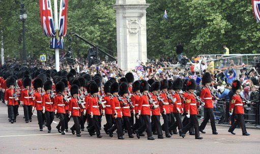 The Queen's Guard walk down The Mall following the wedding ceremony between Prince William and Catherine Middleton, 29 April 2011.