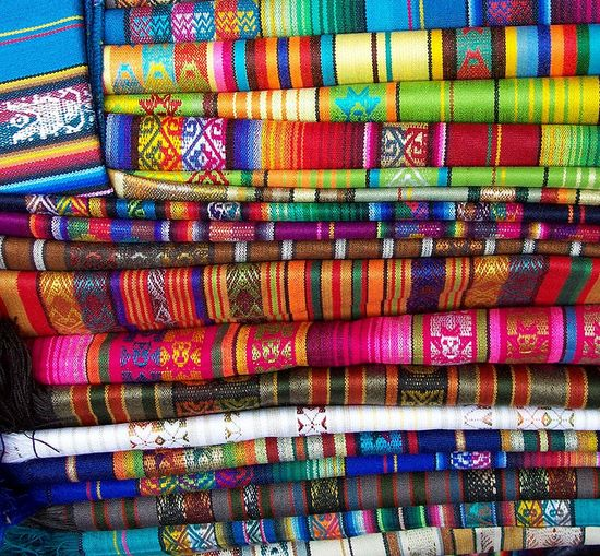 colorful textiles woven by the indigenous Otavaleños of Ecuador