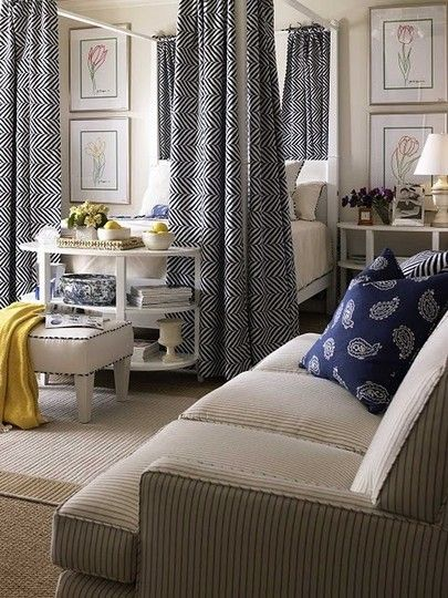 love those bed drapes...great studio apartment decor