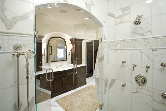 Luxury bathroom design with marble tiles in the shower area