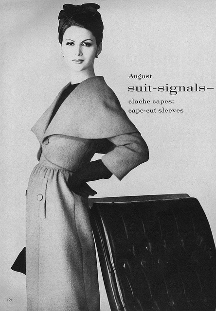 A beautifully tailored cape-cut sleeved coat from 1959. #vintage #fashion #1950s #coat