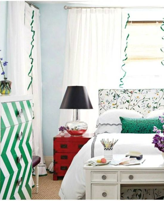 Slipcovered headboard and matching bedskirt.  Also campaign bedside table in red is a lovely pop of color!