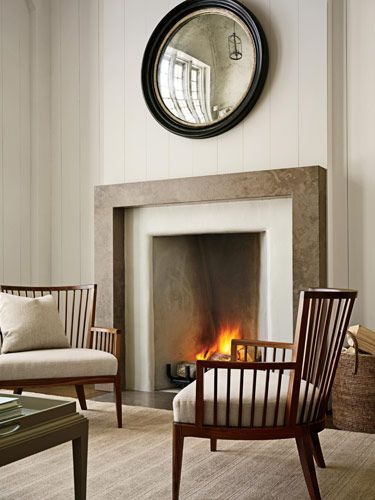Simple stone mantle with paneling above and height of firebox... Barbara Barry