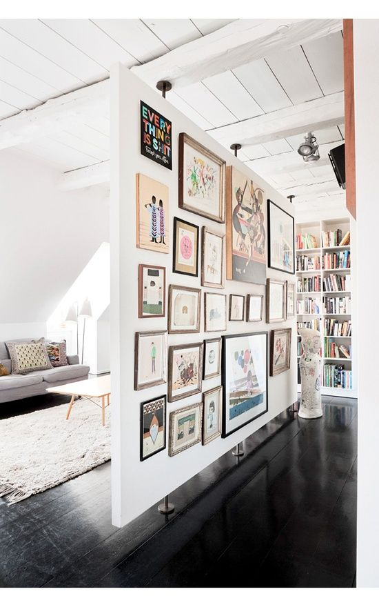 Love this idea for open concept spaces. Gives the illusion of separation, while still leaving the integrity of the space in tact, and is a great opportunity to make a bold statement with your art and photography. Love!.