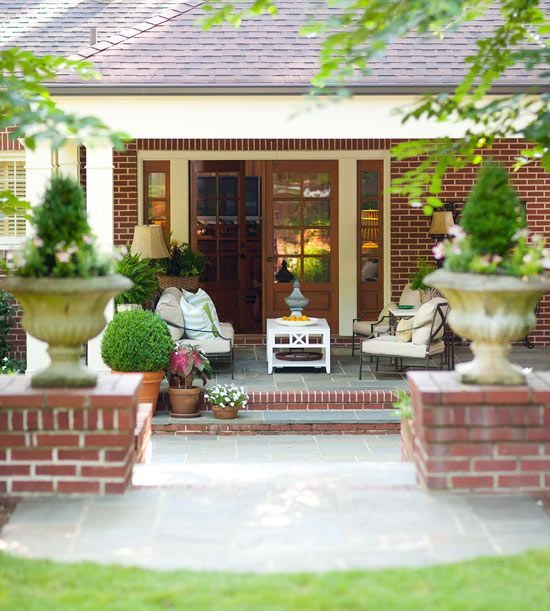 Moving Out Back        Bring a party outdoors by extending living space off the back of your home. This simple porch design features beautiful stone tiling and brick trim tiles, classic columns, and French doors. The furniture looks airy with exposed legs, which also helps make the most of the small space.