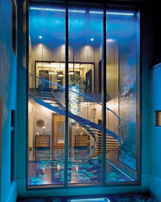 Art Glass Over Staircase with Windows.  Modern house design by Frank McKinney