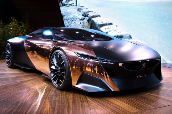 "During the glamorous auto event in Paris was chosen ""The Most Beautiful Concept Car of the Year.  The prize was awarded to the innovative and eco-friendly Peugeot Onyx."