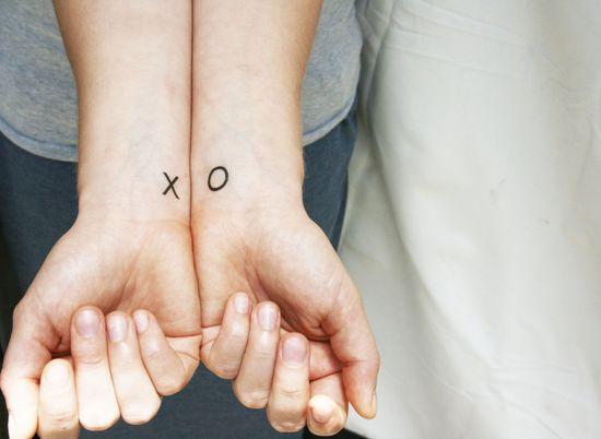 X O tattoo