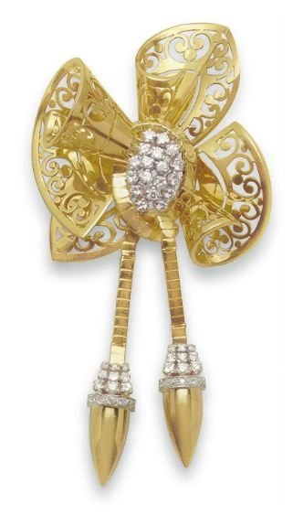 A RETRO DIAMOND AND GOLD BOW BROOCH - Christie's