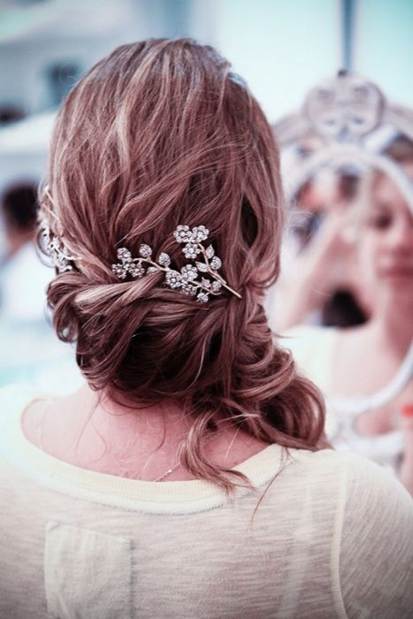 Beautiful side-swept hair and floral pin
