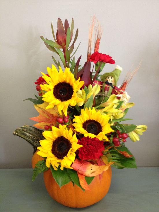 Fresh cut flowers arrangement in a fresh pumpkin