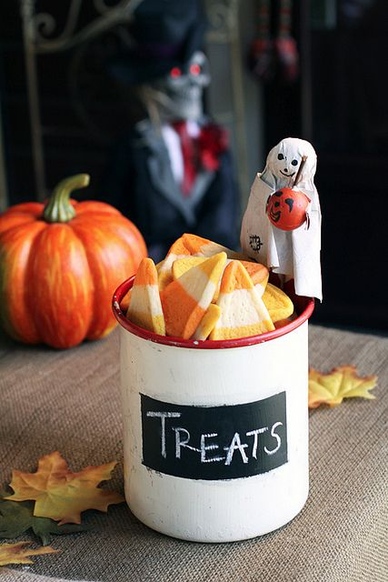A spooktastically adorable little ghost watches over a cup full of yummy Candy Corn Cookies. #cookies #candy_corn #decor #decorations #food #party #kids #Halloween #ghost #pumpkin #fall #autumn #cute