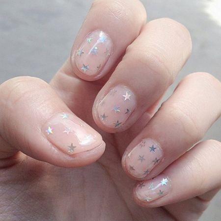 Starry sequins add a little glitz to a simple manicure.