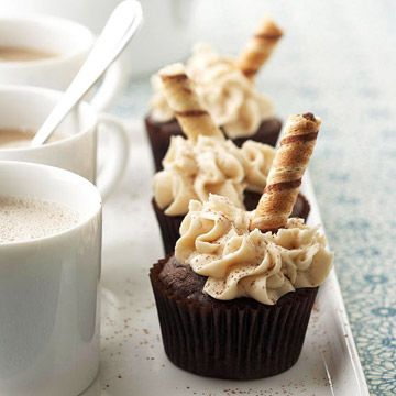 "These sophisticated Mochaccino Cupcakes are topped with swirls of buttercream and a cream-filled cookie ""spoon"" or ""straw."""