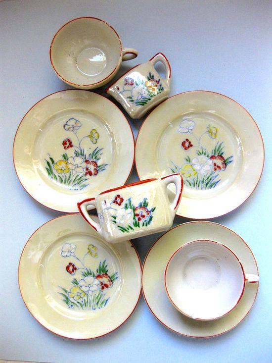 Vintage red trimmed porcelain children's toy tea set.