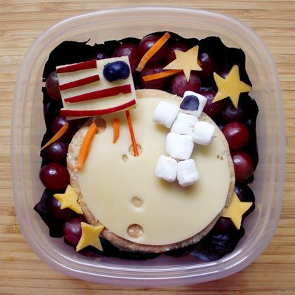 Astronaut Bento Box by spoonful: Made of swiss cheese, turkey and whole wheat sandwich things. Fruits and veggies make up the galaxy and the astronaut is made of minimarshmallows.  #Kids #Bento_Box #Astronaut