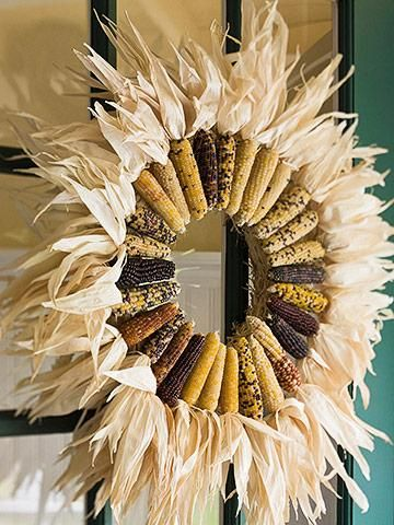 "Sunburst Indian Corn Wreath - Fold out the husks on ears of Indian corn so they point straight out from the tops. Hot-glue the ears to a straw wreath, and ""fluff"" the husks to complete the look. What could symbolize the Midwest as well as corn? This fall, use dried corn to create a wreath"