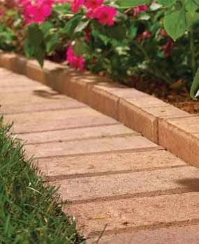 Paver edging makes a good barrier to keep grass from getting in the flower bed and a good path for the lawn mower, so edging the lawn shouldn't be required.
