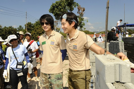 """South Korean actor Seo-Jin Lee (right) pauses for photos with Thai actor Rattapoom """"Film"""" Tokongsup while building at the 2009 Carter Work Project in Chiang Mai, Thailand.  Photos by Habitat for Humanity/Andy Nelson. www.FoxValleyHabi...  Donate today!!"""