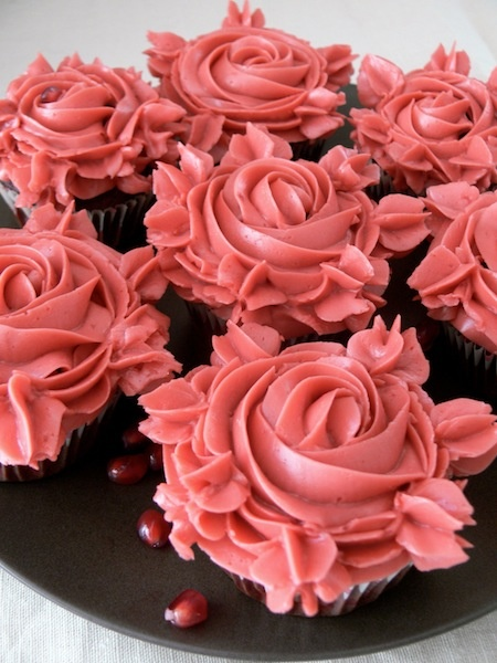 Red Velvet Pomegranate cupcakes with Pomegranate Swiss Meringue Buttercream.