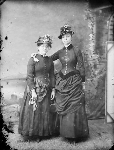 Two stylishly attired Victorian women posing for a studio portrait (such pretty hats). #Victorian #vintage #portraits #women
