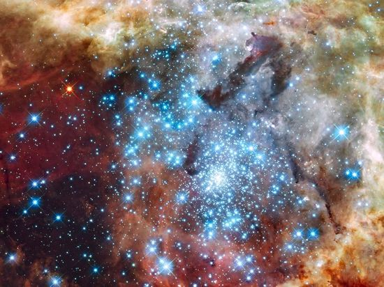 Astronomers using data from NASA's Hubble Space Telescope caught two clusters full of massive stars that may be in the early stages of merging. The 30 Doradus Nebula is 170,000 light-years from Earth. What at first was thought to be only one cluster in the core of the massive star-forming region 30 Doradus has been found to be a composite of two clusters that differ in age by about one million years.