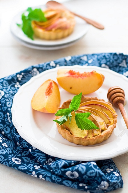 Fresh, summer, totally tasty Peach tarts.  #cooking #food #foodie #delicious #foodphotography #tarts #peaches #fruit #baking #pies #summer #mint #honey #beautiful