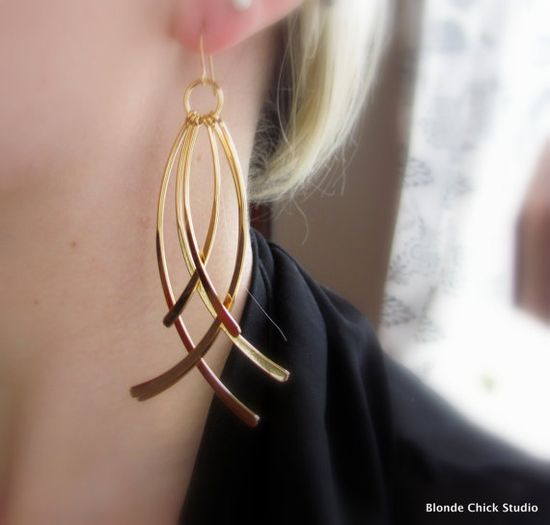Simple gold earring which works with the direction of the coiled wire and has plannished ends. #wire #jewelry #earrings