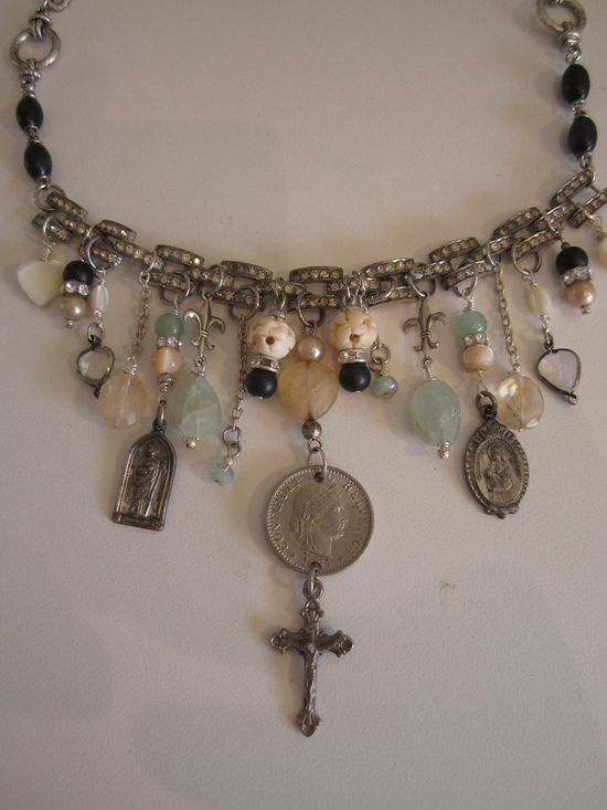 religious repurposed assemblage necklace charm crucifix rhinestone bracelet rosary beads. $150.00, via Etsy.