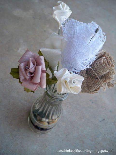 Handmade flowers in recycled bottles