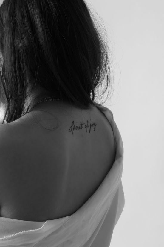 upper back tattoo.