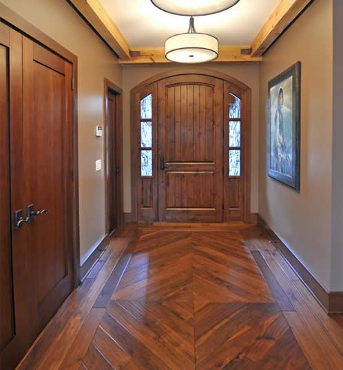 new rustic entry. Love the wood floor design.