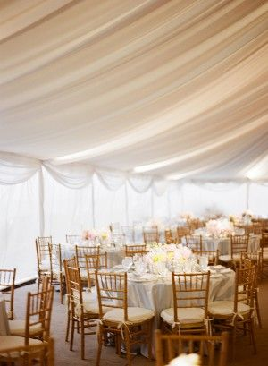 ivory chiffon gently draped over a wedding reception = gorgeous!