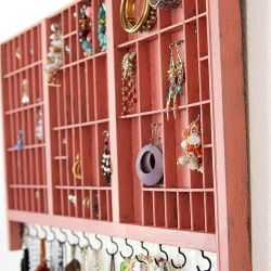 A type set tray re-purposed into a jewelry organizer
