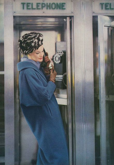Looking especially chic in shades of blue and brown while making a telephone call, 1958. #vintage #fashion #1950s #hat