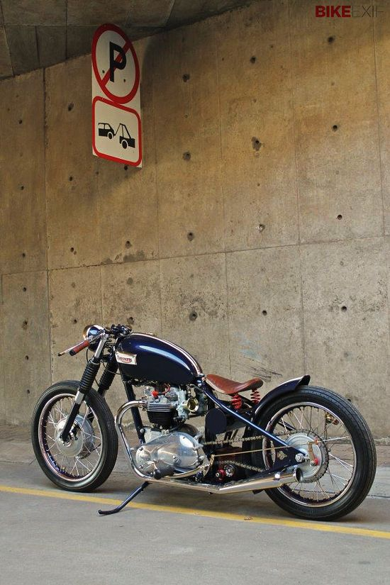 Classic lines and timeless style: a 1969 Triumph Bonneville bobber from Johannesburg, with Brooks leather grips and a Lowbrow Customs hardtail.