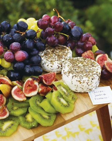 A vibrant display of goat cheese and fresh fruits.