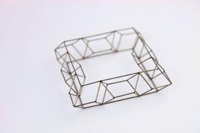 Emma Gregory, Grid Development 13.02  Laser welded stainless steel bracelet. - Glasgow School of Art - at New Designers 2013
